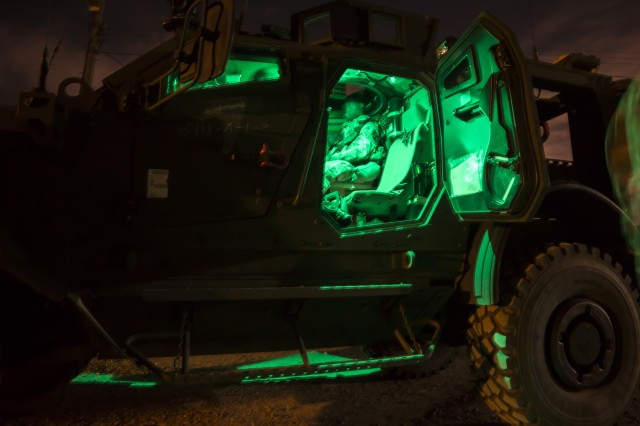A U.S. Army Soldier, assigned to 2nd Infantry Division, 2nd Sustainment Brigade, is ready to take his turn during night gunnery qualifications near Warrior Base, South Korea, on Sept. 18, 2018. Vehicle crew evaluators (VCE) were present to offer feedback on crew duties, and to make sure each crew could be properly certified on their gunnery tables. (U.S. Army Photo by Spc. Adeline Witherspoon, 2nd Sustainment Brigade)
