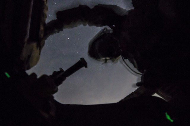 Under starry skies, a U.S. Army Soldier, assigned to 2nd Infantry Division, 2nd Sustainment Brigade, secures his position during night gunnery qualifications near Warrior Base, South Korea, on Sept. 18, 2018. The Soldiers qualified on both day and night marksmanship training while operating a MRAP All-Terrain Vehicle (MATV). (U.S. Army photo by Spc. Adeline Witherspoon, 2nd Sustainment Brigade)