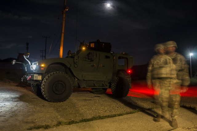 U.S. Army Soldiers assigned to 2nd Infantry Division, 2nd Sustainment Brigade, wait their turn to begin night-fire training operations near Warrior Base, South Korea, on Sept. 18, 2018. The Soldiers qualified on both day and night marksmanship training while operating a MRAP All-Terrain Vehicle (MATV). (U.S. Army photo by Spc. Adeline Witherspoon, 2nd Sustainment Brigade)