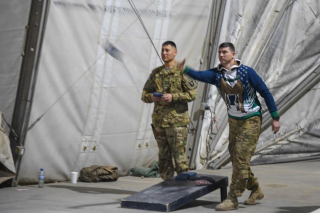 6th Battalion,Task Force Shadow, 101st Combat Aviation Brigade, 101st Airborne Division ( Air Assault), celebrated the holidays with festivities that included an ugly sweater contest, cornhole, card games, open microphone karaoke, and a hair cut raffle at Bagram Airfield, Afghanistan Dec. 23, 2018.