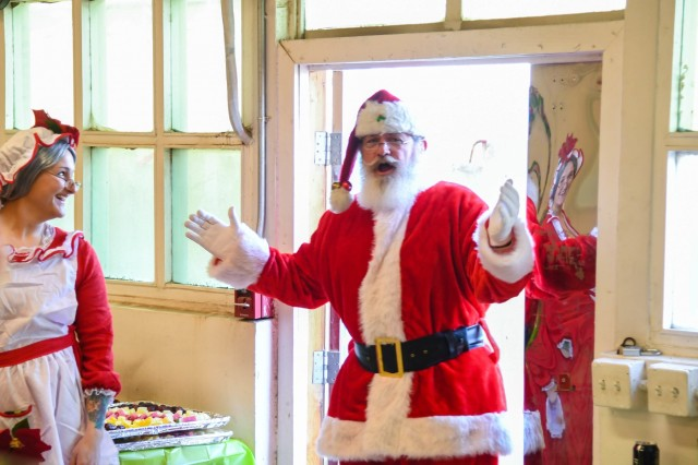 "Headquarters and Headquarters Company ""Hellcats"", 101st Combat Aviation Brigade, 101st Airborne Division ( Air Assault), celebrated the holidays with festivities at Bagram Airfield, Afghanistan Dec. 26, 2018 that included events such as an ugly t-shirt contest, ping pong, cornhole, bingo, Foosball, darts, family feud, cue sports and plinko! The Hellcats even enjoyed a special visit from Mr. and Mrs. Santa Claus."