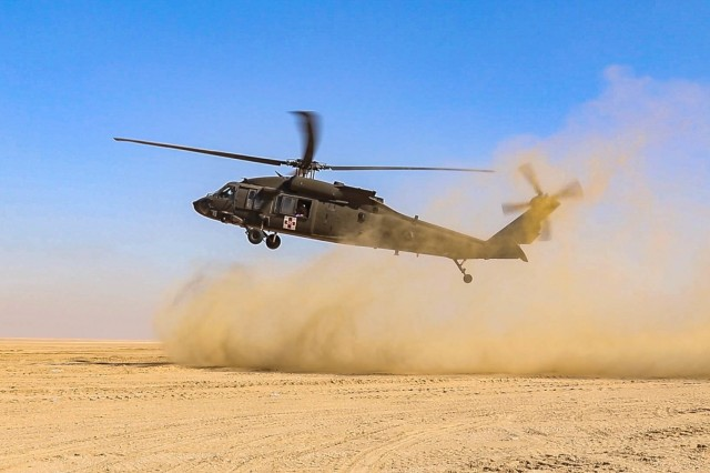 A UH-60L Black Hawk helicopter prepares to land during an aeromedical evacuation rehearsal at Udairi Range Complex near Camp Buehring, Kuwait, Dec. 11, 2018.  The rehearsal was conducted to prepare for Operation Desert Observer II, a combined arms live-fire exercise with Task Force Spartan and the Kuwaiti Land Forces, to validate protocols and strengthen communications between the ground teams and aviation assets.