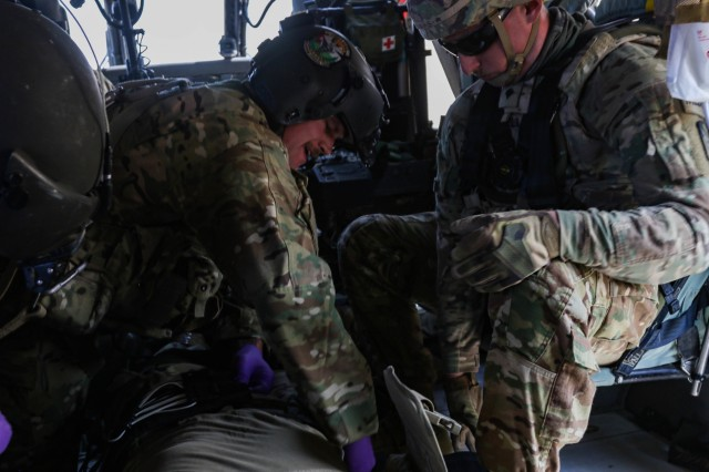 U.S. Army Sgt. Pete Erickson, a flight paramedic assigned to C. Company, 2-211th General Support Aviation Battalion, Minnesota Army National Guard, pats down a patient during an aeromedical evacuation rehearsal to check for open wounds at Camp Buehring, Kuwait, Dec. 11, 2018.  The rehearsal was conducted to prepare for Operation Desert Observer II, a combined arms live-fire exercise with Task Force Spartan and the Kuwaiti Land Forces, to validate protocols and strengthen communications between the ground teams and aviation assets.