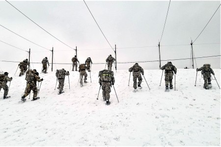 Students in Cold-Weather Operations Course 19-01 practice snowshoeing, Dec. 6, 2018, at Fort McCoy, Wis. The course is 14 days long and includes training in a wide range of cold-weather subjects, including skiing and snowshoe training, using the ahkio sleds, setting up the Arctic 10-person cold-weather tent, and more. Training also focuses on terrain and weather analysis, risk management, cold-weather clothing, developing winter fighting positions in the field, and camouflage and concealment.