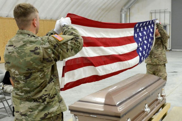 Army National Guard Soldiers from several different states participate in Level 1 Funeral Honors Training Dec. 13, 2018, at Camp Pendleton in Virginia Beach, Virginia. With the help of the VNG Funeral Honors team and instructors from each of the represented states, the group learned the finer points of properly folding and presenting the U.S. flag to the veteran's next of kin, as well proper handling of the casket as pallbearers.