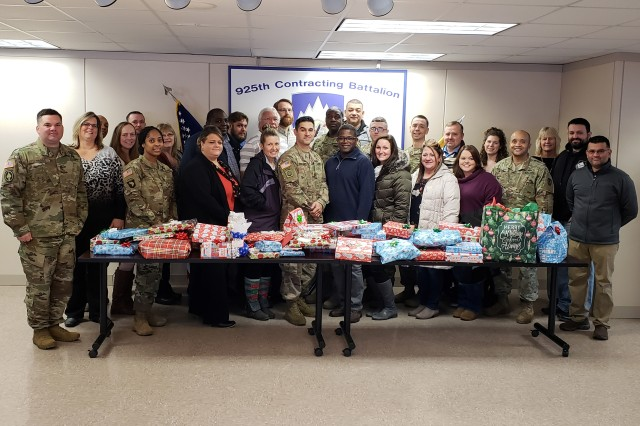Members of the 925th Contracting Battalion and Mission and Installation Contracting Command-Fort Drum, New York, partnered with local charity Watertown Urban Mission to sponsor a family in need during the Christmas holiday.