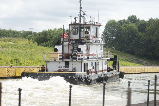 A tugboat hums along the Ohio River at Lock 52 near Brookport, Ill.
