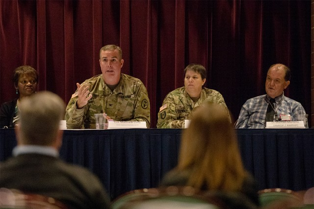 "Col. (Dr.) Matthew Cody, chief of Inpatient Psychiatry at Madigan speaks on a panel of clinicians and case managers at the ""Connect with Community"" Behavioral Health Conference at the McChord Club on Dec. 6."