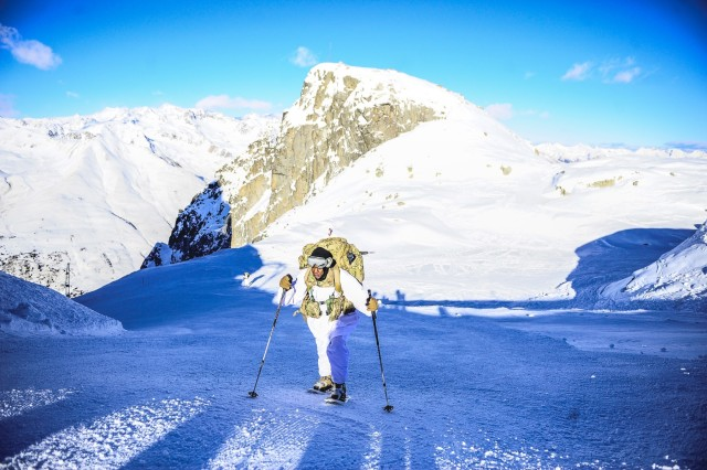 Paratroopers assigned to the 173rd Airborne Brigade summit a mountain peak during intense cold weather training with Alpine Brigade Julia during exercise Alpini Climb, Dec. 11, 2018, in Passo di Tonale, Italy.