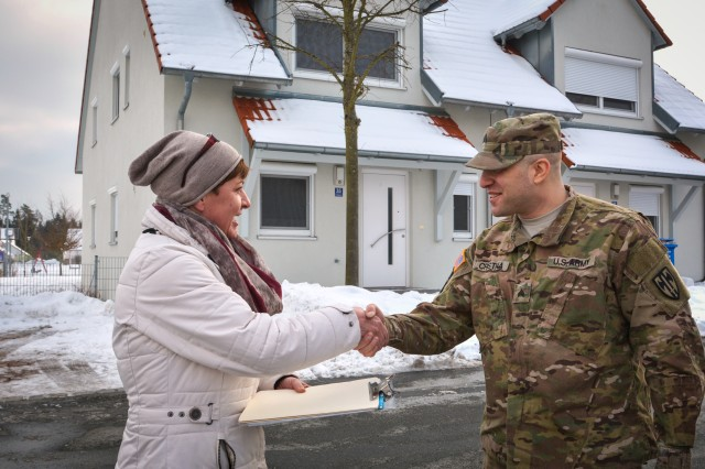 Yvonne Sullivan helps a Soldier with housing at U.S. Army Garrison Bavaria, Germany.  Sullivan is with the Bavaria housing office. Soldiers and Family members can rate Family housing owned and leased by the Army through a survey that runs Jan. 15 through Feb. 14. The survey includes housing in the United States and overseas, such as the Army housing at U.S. Army Garrison Bavaria.