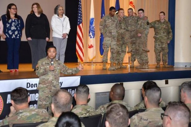 Command Sgt. Maj. Walter Tagalicud, I Corps command sergeant major, talks about the Army Emergency Relief program with service members at the Joint Base Lewis-McChord AER kickoff event in 2018.