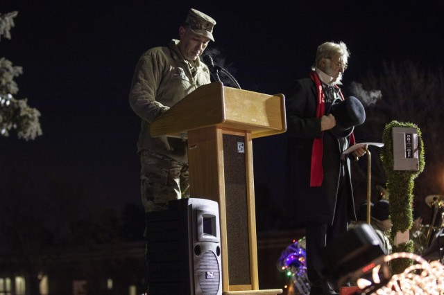 """Lt. Col. Robert Lewis, Fort Carson deputy garrison chaplain, leads the invocation during the annual tree lighting ceremony at the William """"Bill"""" Reed Special Events Center Fort Carson, Colo., Dec. 6, 2018. (U.S. Army photo by Sgt Daphney Black)"""