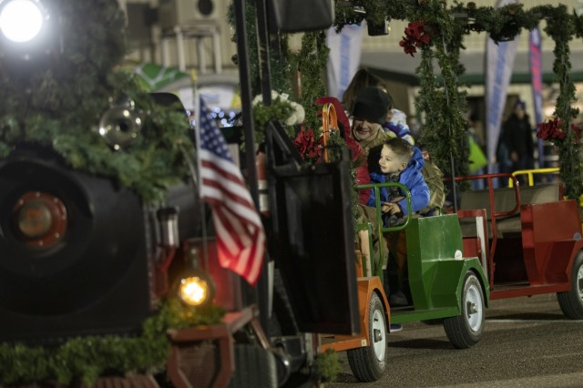 """The """"Polar Express"""" train rolls around the William """"Bill"""" Reed Special Event Center parking lot giving holiday rides to attendees of the annual tree lighting ceremony, Fort Carson, Colo., Dec. 6, 2018. (U.S. Army photo by Sgt. Daphney Black)"""