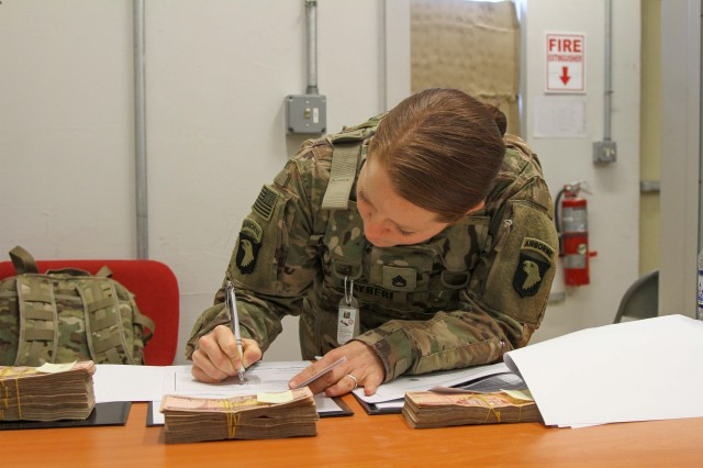 Staff Sgt. Dalisha Mayberry, native of Lake Arthur, Louisiana, and senior paralegal noncommissioned officer in charge for the 101st Resolute Support Sustainment Brigade, 101st Airborne (Air Assault) Division, preps foreign claims paperwork and ensures that all fund amounts are accurate and accounted for during a foreign claims payout mission, December 22, 2018, on Bagram Airfield, Afghanistan. The mission of the 101st RSSB foreign claims team is to ensure that all foreign claims made in relation to USFOR-A operations are handled efficiently and thoroughly. (U.S. Army photo by Staff Sergeant Caitlyn Byrne, 101st RSSB Public Affairs)