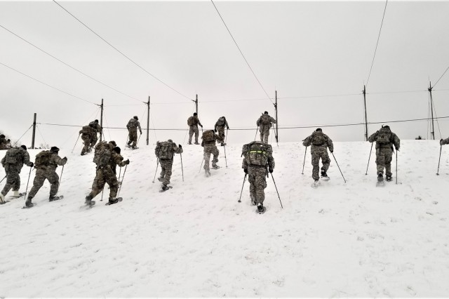 Students in Cold-Weather Operations Course 19-01 practice snowshoeing at a training area Dec. 6, 2018, on the Fort McCoy, Wis., cantonment area. The class has 38 students. The course is 14 days long and, in addition to classroom training, includes training in a wide range of cold-weather subjects, including skiing and snowshoe training, using the ahkio sleds, setting up the Arctic 10-person cold-weather tent, and more. Training also focuses on terrain and weather analysis, risk management, cold-weather clothing, developing winter fighting positions in the field, and camouflage and concealment. (U.S. Army Photo by Joe Ernst, Cold-Weather Operations Course, Fort McCoy, Wis.)