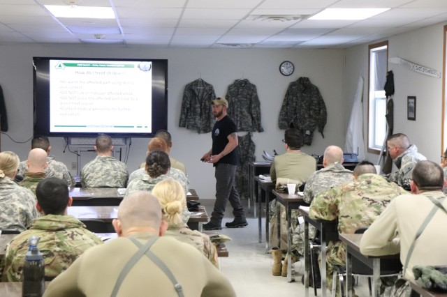 Instructor Joe Ernst with the Cold-Weather Operations Course discsusses how to prevent cold-weather injuries during the first day of training Dec. 3, 2018, for Class 19-01 in the course at Fort McCoy, Wis. The course is 14 days long and, in addition to classroom training, includes training in a wide range of cold-weather subjects, including skiing and snowshoe training, using the ahkio sleds, setting up the Arctic 10-person cold-weather tent, and more. Training also focuses on terrain and weather analysis, risk management, cold-weather clothing, developing winter fighting positions in the field, and camouflage and concealment. (U.S. Army Photo by Scott T. Sturkol, Public Affairs Office, Fort McCoy, Wis.)