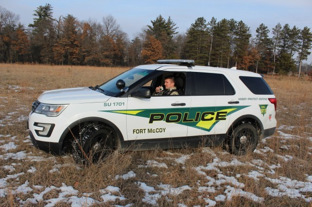 Game Warden Jesse Haney with the Directorate of Emergency Services Police Department works in the field Dec. 26, 2018, at Fort McCoy, Wis. Haney, along with Game Warden Art Casserberg, support Fort McCoy's Police Department in enforcing game and related regulations and laws on post. Haney began as a warden in December 2018 following several years as a police officer at the installation. (U.S. Army Photo by Scott T. Sturkol, Public Affairs Office, Fort McCoy, Wis.)