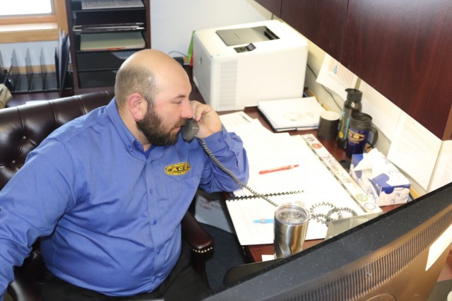 Program Manager Jaime Herrera with Fort McCoy Army Community Service (ACS) works at his desk Dec. 18, 2018, at Fort McCoy, Wis. Herrera is new to the Fort McCoy ACS office, and he formerly served at Fort McCoy with the 181st Multi-Functional Training Brigade. Herrera will support mobilization/deployment readiness, Army Family Action Plan, and Army family team-building activities at ACS. (U.S. Army Photo by Scott T. Sturkol, Public Affairs Office, Fort McCoy, Wis.)