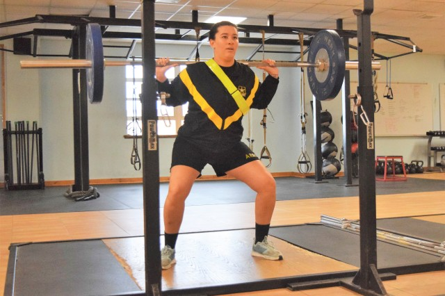 Spc. Destiny Kendall, Headquarters and Headquarters Company, Special Troops Battalion, 1st Infantry Division Sustainment Brigade, performs squats at King Field House a feat she was told she would not be able to do after receiving a permanent profile in May 2018.