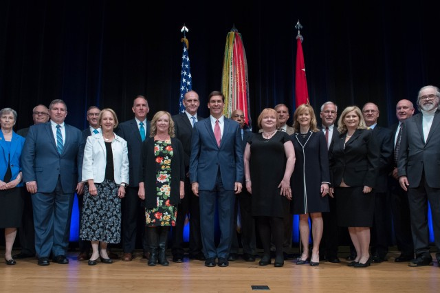 Secretary of the Army Dr. Mark Esper stands with recipients of the annual Presidential Rank Awards presented in 2018 at the Pentagon. Army civilians who receive a Presidential Rank Award represent employees who have made extraordinary contributions to Army readiness and who exemplify what it means to be a Ready Army Civilian.