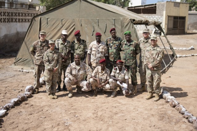 Djibouti Army (FAD) soldiers pose with U.S. Army Soldiers from the Combined Joint Task Force-Horn of Africa communications directorate, after working together to set up a satellite unit during an Africa Data Sharing Network (ADSN), version two, information exchange with FAD soldiers at FAD Headquarters, Djibouti, Dec. 26, 2018. The ADSN works as an internal network that the African Union Mission in Somalia troop-contributing countries can use to communicate and share information amongst each other.