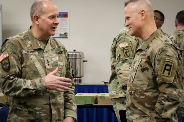 Lt. Gen. Thomas James, Commanding General, First Army (right) and Lt. Gen. Timothy J. Kadavy, Director, Army National Guard, talk during a working lunch at the Green Tab Commanders Conference at the Professional Education Center in Little Rock, Arkansas January 4. During the conference James focused on the importance of the First Army partnership with the National Guard and First Army's mission to help generate forces for the missions at hand. More than 500 National Guard leaders attended the conference.