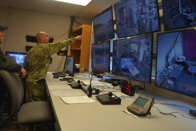Pine Bluff Arsenal Commander, COL Luis A. Ortiz, observes activities in the U.S. Army Chemical Materials Activity Recovered Chemical Materiel Directorate (RCMD) command post at the Pine Bluff Explosive Destruction System located at Pine Bluff Arsenal, Arkansas. RCMD continues to enhance, expand and innovate technologies to meet the needs for the evolving RCWM program.