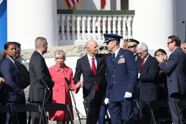 Brig. Gen. Brian Simpler, Assistant Adjutant General-Air, escorts Florida Senator Rick Scott, the outgoing governor of Florida, who was in attendance for the swearing in of newly elected governor Ron DeSantis, in Tallahassee, Fla., Jan. 8, 2019. Gov. DeSantis is the state's 46th governor, replacing Scott, who was elected to the position of state senator.