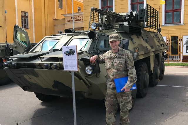 New York Army National Guard 1st Lt. James Pistell the executive officer of Headquarters and Headquarters Troop 2nd Battalion, 101st Cavalry poses by a Ukrainian personnel carrier, at the Yavoriv Combat Training Center near Livov, Ukraine on May 17, 2018. Pistall has developed a map graphics application based on his experiences supporting Ukrainian Army military training in 2018.