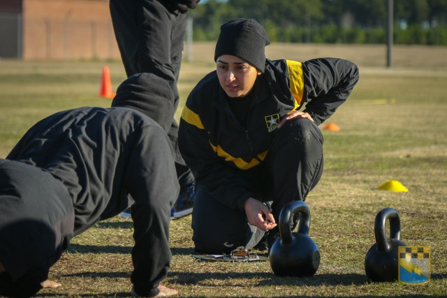 Staff Sgt. Idis Arroyo, assigned to Alpha Company, 519th Military Intelligence Battalion, 525th Military Intelligence Brigade, grades a Soldier on the hand release push-ups event during the field testing of the Army Combat Fitness Test at Fort Bragg, N.C. on Jan. 9, 2019.