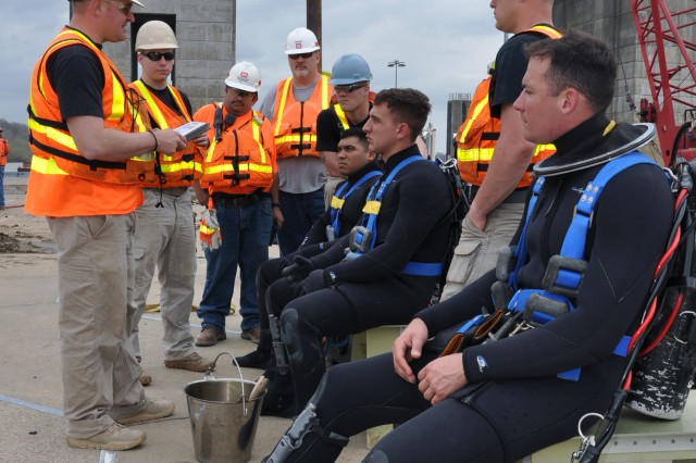 Army engineer divers contributed to 12 underwater dives in 2014, where they helped provide maintenance during Olmsted's construction. They acted as dive supervisors and hard hat divers, inspecting and cleaning lock culverts. The Corps of Engineers brought in military and civilian divers to help complete maintenance efforts.