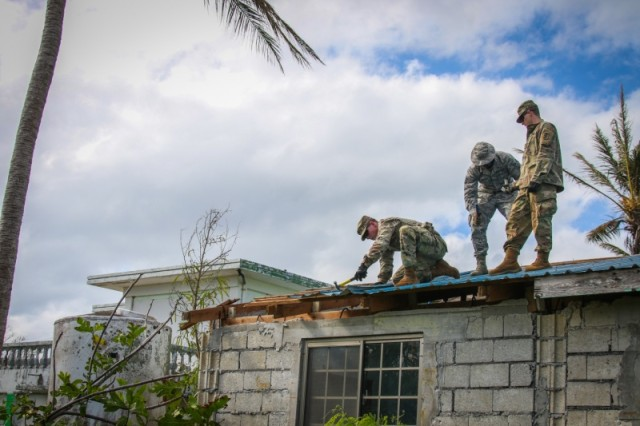 SAIPAN, Commonwealth of the Northern Mariana Islands (Jan. 7, 2019) -- Soldiers and Airmen from Task Force Engineer removes damaged roofing at a home in Saipan, Commonwealth of the Northern Mariana Islands Jan. 7. Task Force Engineer is tasked with providing much-needed temporary roofing to the residents of Saipan who are recovering from Super Typhoon Yutu. Military service members from Joint Region Marianas and Indo-Pacific Command are proud of their efforts to support the Federal Emergency Management Agency and work with the CNMI's civil and local officials to recover from the devastating impacts of Super Typhoon Yutu. (U.S. Army photo by SPC Geordan Tyquiengco)
