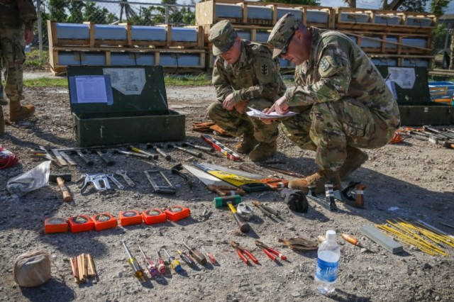 SAIPAN, Commonwealth of the Northern Mariana Islands (Jan. 7, 2019) -- Soldiers from Task Group Engineer conduct a layout of equipment Jan. 7, to ensure they have what they need before heading out to build much-needed temporary roofing for residents of Saipan affected by Super Typhoon Yutu. Military service members from Joint Region Marianas and Indo-Pacific Command are proud of their efforts to support the Federal Emergency Management Agency and work with the CNMI's civil and local officials to recover from the devastating impacts of Super Typhoon Yutu. (U.S. Army photo by Sgt. 1st Class Wynn Hoke)