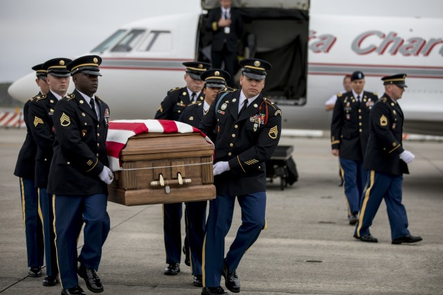 Soldiers with the North Carolina National Guard's Military Funeral Honors Team carry the casket of Sgt. James Slape during his honorable transfer at Marine Corps Air Station Cherry Point, Nov. 9, 2018. Lt. Col. Doug Ralph, commander of the Mission and Installation Contracting Command-Fort Belvoir contracting office in Virginia, served as a special escort for the transfer. Slape was killed in action October 4, 2018, while serving in Afghanistan with the 430th Ordnance Company in support of Operation Resolute Support and Freedom's Sentinel.