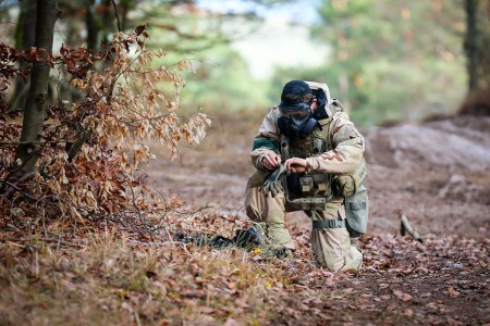 A Soldier assigned to 1st Cavalry Division, dons his gloves during a simulated gas attack at Combined Resolve XI in Hohenfels, Germany, Dec. 7, 2018.