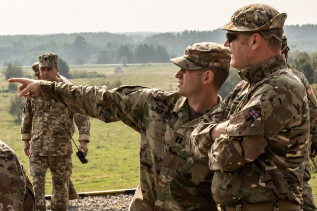 Cpt. Thomas Bentley talis with a British Major during an exercise, Sept. 4, 2018.