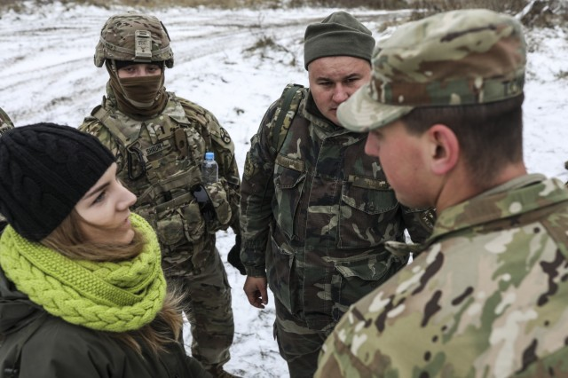 278th Armored Cavalry Regiment Soldiers, 1st Lt. Logan Shrum and 1st Lt. Cruz Tomblin speak with multinational Soldiers in the field, Nov. 22, 2018.