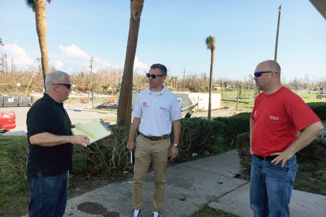 "Members of the Critical Public Facilities (CPF) Team are in Florida to execute the FEMA CPF mission. On their first day in Florida, the team focused on quick preliminary assessments of mainly fire stations in impacted communities. Here Jason Doktor, Josh Feldmann, and James Scungio discuss the mission. ""It's good to be out assessing these facilities in the field, and to show folks that there are people here helping,' said Scungio. ""To give people hope and make sure people know they're not abandoned."" (U.S. Army photo by Chris Gardner)"