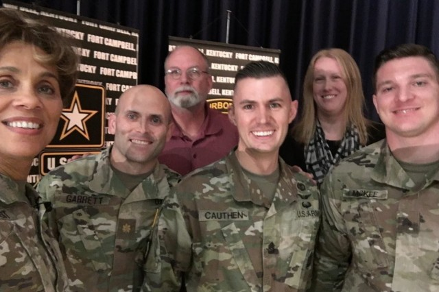 Lt. Gen. Nadja West, Community Care Unit Nurse Case Manager Mrs. Jessica Buehler and members of Fort Campbell cadre are all smiles during an October 30, 2018 town hall meeting and recognition ceremony.  (Photo courtesy of Jessica Buehler)
