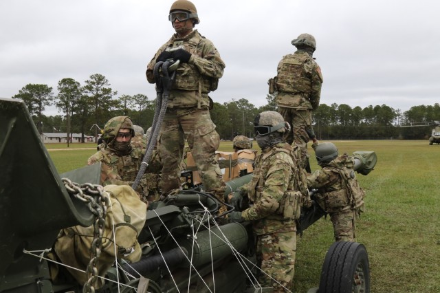 "Marne Air Soldiers hovers over M777 Howitzer, with their CH-47 to support the 1st Battalion, 118th Field Artillery regiment ""Hickory Howitzer"" Soldiers in their Gunnery Table II certification Nov. 15 at Fort Stewart, Ga."
