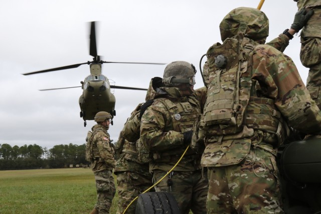Soldiers from 1st Battalion, 118th Field Artillery regiment 48th Infantry Brigade Combat Team, 3rd Infantry Division conducts sling load operations with, Nov. 15 at Fort Stewart, Ga.