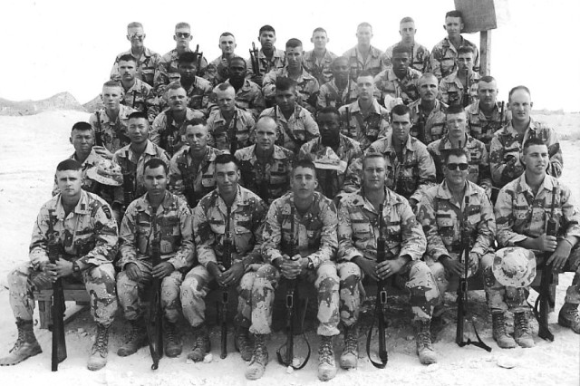 In 1990, Col. William Ostlund (front row, far left) during his younger days and his first combat deployment during Desert Shield with 3rd Platoon, Bravo Company, 187th Infantry Regiment.
