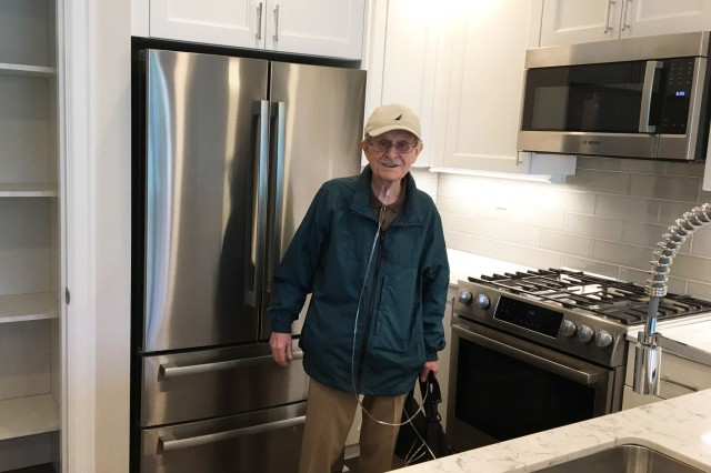 John Curtis, a Madigan cancer patient, is moving into his new home with the help of his Madigan care team, his condo development team, and the City of Tacoma.