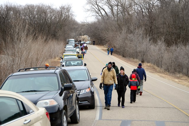 Adventurers file from their vehicles Jan. 1 at Tuttle Creek State Park during the First Day Hike. The national event featured about 80 people and is part of the larger event happening in all 50 states with an anticipated 100,000 plus attendance.