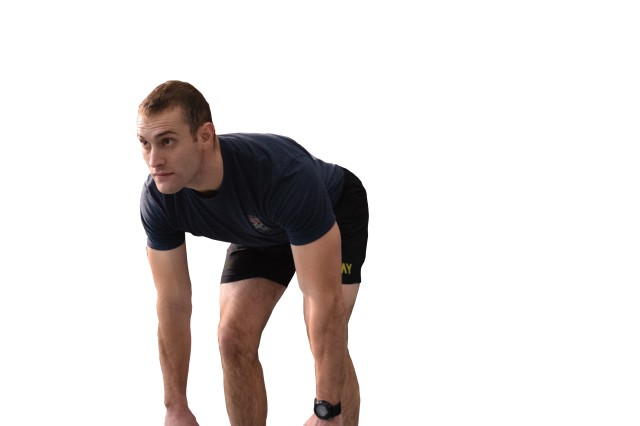 3  Maintaining a slow pace, bend at the waist and lowering the kettlebells toward the floor.