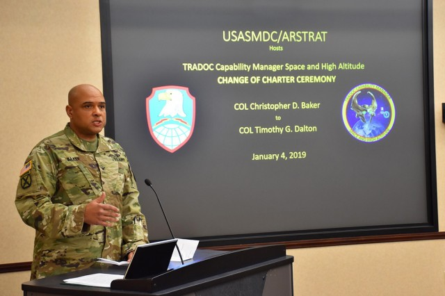Col. Christopher Baker discusses the significance and accomplishments of the U.S Army Training and Doctrine Command Capabilities Manager for Space and High Altitude during a Jan. 4, 2019, Change of Charter at Redstone Arsenal, Alabama. Baker, SMDC's outgoing TCM SHA, established the office in July 2015. During the ceremony, Baker relinquished his responsibilities to Col. Timothy G. Dalton who received a new charter from the four-star commanding general of TRADOC. The TCM SHA belongs to SMDC's Future Warfare Center but receives operational authority through TRADOC's commanding general. (U.S. Army photo by Ronald C. Bailey)