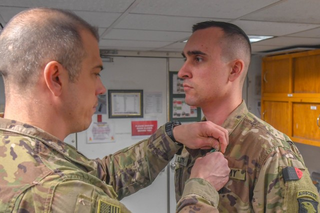 Capt. Ethan Bilotti, assigned to Headquarters and Headquarters Company, 101st Combat Aviation Brigade, 101st Airborne Division ( Air Assault), is presented the Army Commendation Medal at Bagram Airfield, Afghanistan Jan. 8 2019. Bilotti will head back and continue to support operations at home station.