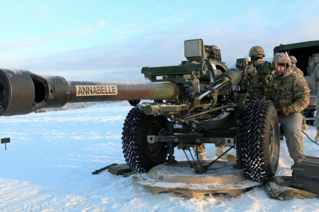 Paratroopers with Alpha Battery, 2nd Battalion, 377th Parachute Field Artillery Regiment, 4th Infantry Brigade Combat Team (Airborne), 25th Infantry Division, prepare to fire their M119 Howitzer, certifying their capability to shoot accurately in a timely and safe manner, Jan. 10, 2019, at Joint Base Elmendorf-Richardson, Alaska.