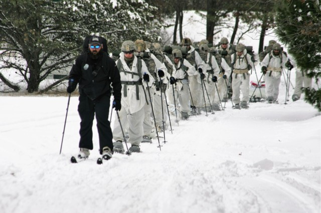 Instructor Hunter Heard leads students in Cold-Weather Operations Course (CWOC) Class 18-06 in snowshoe training March 7, 2018, at Fort McCoy, Wis. The students were all Soldiers. CWOC students are trained on a variety of cold-weather subjects, including snowshoe training and skiing as well as how to use ahkio sleds and other gear. Training also focuses on terrain and weather analysis, risk management, cold-weather clothing, developing winter fighting positions in the field, camouflage and concealment, and numerous other areas that are important to know in order to survive and operate in a cold-weather environment. The training is coordinated through the Directorate of Plans, Training, Mobilization and Security at Fort McCoy. (U.S. Army Photo by Scott T. Sturkol, Public Affairs Office, Fort McCoy, Wis.)