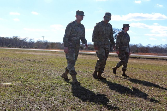 Army Reserve Soldiers with the 420th Engineer Brigade are about to walk into a mine trip wire (lower left) during their mine clearing class at the Bryan Armed Forces Reserve Center in Bryan, Texas, for their January 2019 battle assembly. The 420th is a multifaceted engineer brigade with specialists in construction, bridge erection, road emplacement, and mine clearing. Photo by Army Reserve Sgt. Rigo Cisneros, 211th Mobile Public Affairs Detachment.